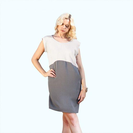 Shiftkleid aus TENCEL in Rose-Grau. Klei dmit geradem Schnitt, seitlichen Taschen, ober Rosé und unten Grau. Kurzärmelig und mit Rückenausschnitt.