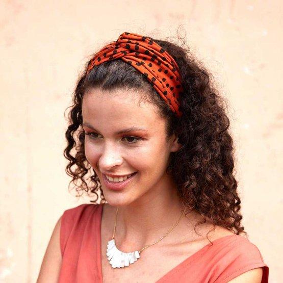 rostrotes Stirnband mit schwarzen Tupfen aus Bio-Baumwolle